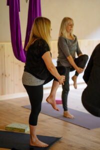 The beginning of an aerial yoga class in the Yogandspice Studio.