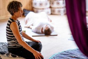 Lorraine guiding a yoga class in the Yogandspice Studio.
