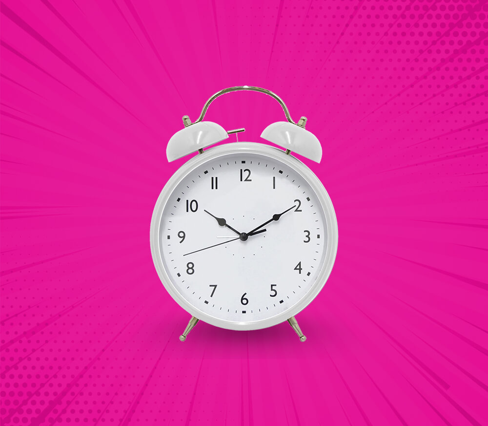 White Alarm Clock with Pink Background