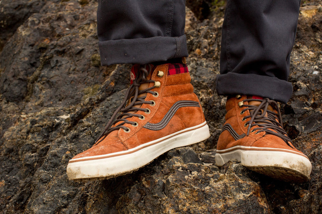 a man wearing vans in the woods