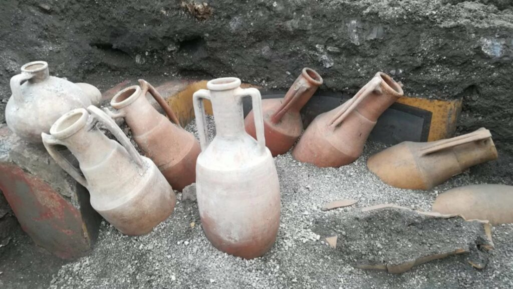 Archaeologists found amphorae, which look just like the ones in the painting, in front of the eatery.