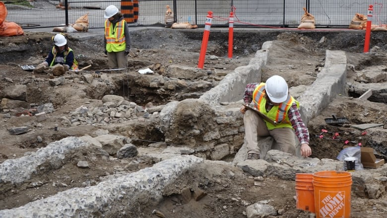 Workers on Parliament Hill dig through the remains of one of the three barracks used to house soldiers and their wives from 1826 to the late 1850s, during the initial stages of the Rideau Canal's construction.