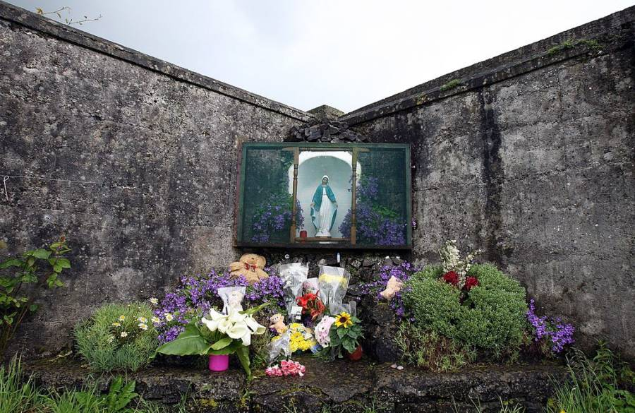 This picture shows a shrine in Tuam, County Galway in memory of the children buried there without a grave.