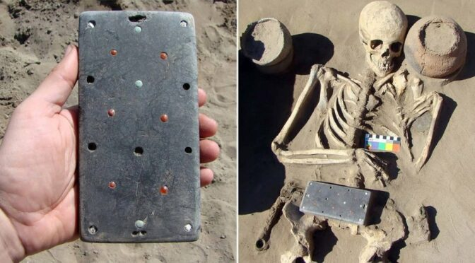 Archaeologists find an ancient skeleton buried with '2,100-year-old iPhone'