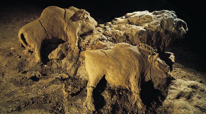 Museum of Artifacts: 14000 years old bisons sculpture found in Le Tuc d'Audoubert cave. Ariege, France.