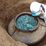 A Ceramic Jar Filled with Thousand of bronze coins Unearthed at the site of a 15th-century Samurai Residents