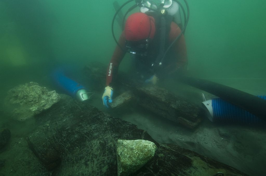 An archaeologist examines how the ancient vessel's keel was put together.