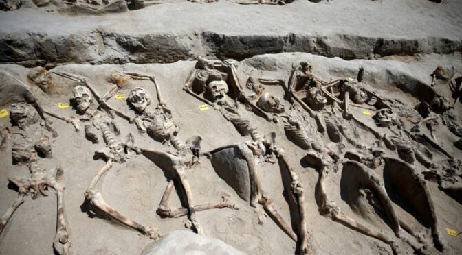 More than 80 shackled skeletons found in an ancient mass grave