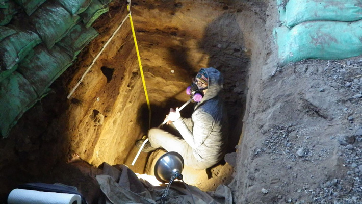 Archaeologist Lisa-Marie Shillito collecting cave samples.