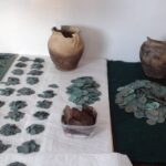 A hidden hoard of more than 6,000 silver coins found in a forest in Poland