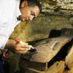 Archaeologists uncover coffins at the ancient Egyptian burial site