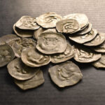 Tourist finds ancient silver coins under an uprooted tree