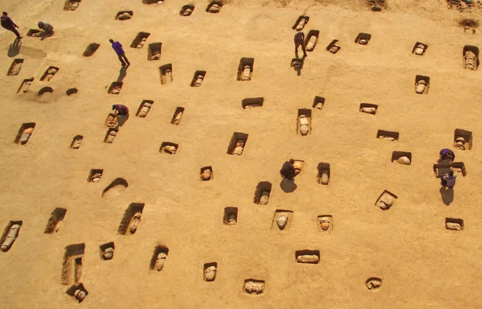 Haunting pictures show a mass grave of 113 ancient human remains buried in clay pots in China