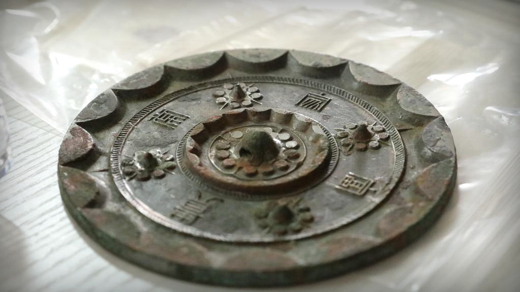 Over 2,000-year-old bronze mirrors unearthed at a cemetery in NW China