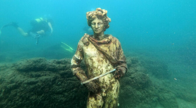 Tourists dive into an underwater archaeological Roman party town
