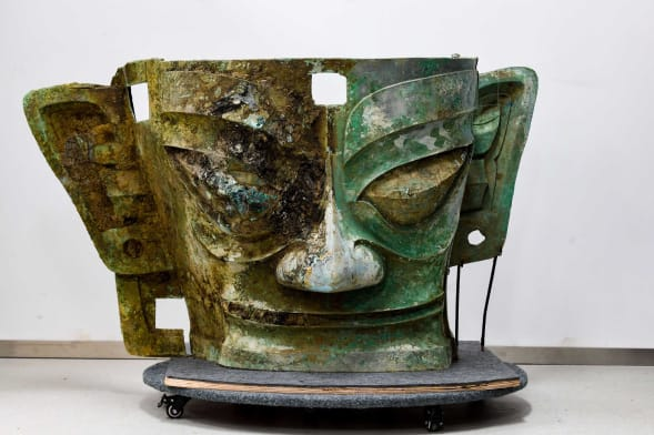 A bronze mask was discovered in one of the eight sacrificial pits discovered at the Sanxingdui ruins site