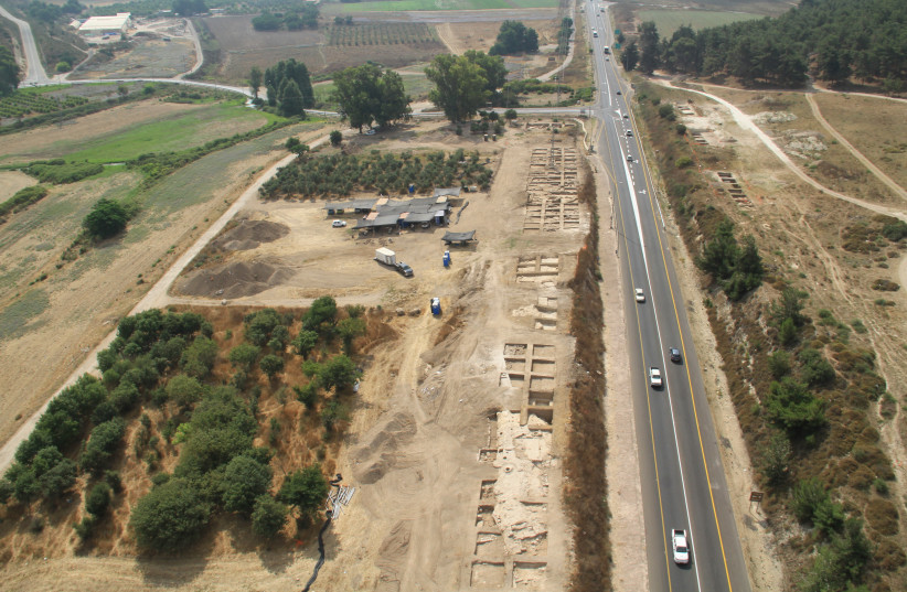 Aerial view of the excavations at Ein Tzipori during the 2012 season. Looking east, with Field I to the left and Field II to the right of Road 79.