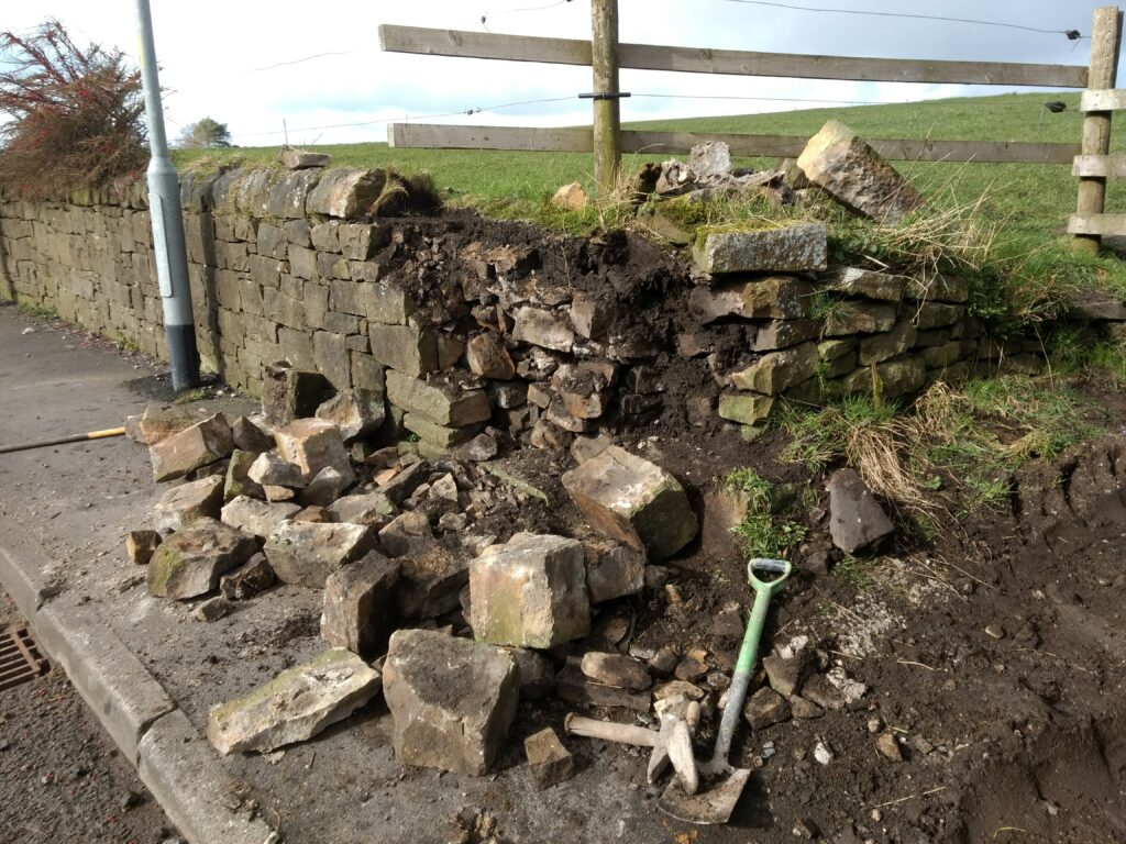 dry stone wall in mellor dmaged