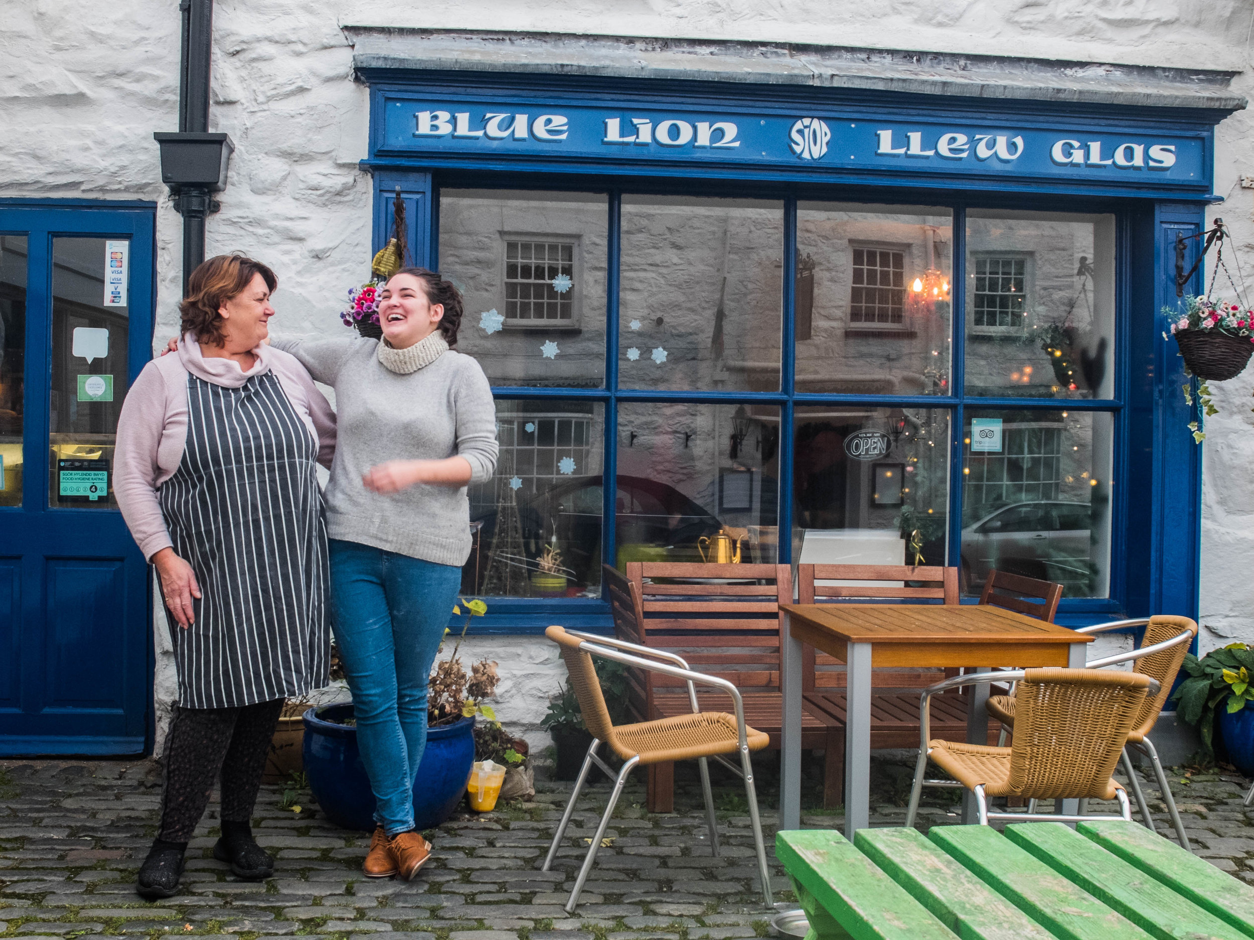 outside the Llew Glas cafe, on the Blue Lion square in Harlech