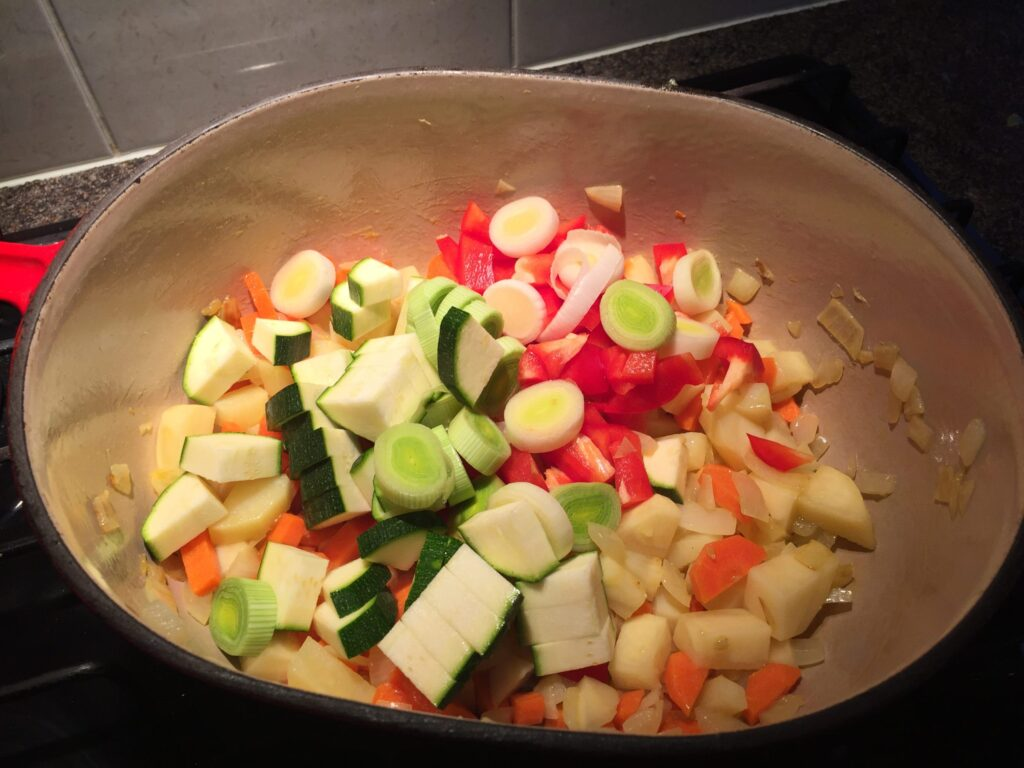 Adding the pepper, leek and courgette