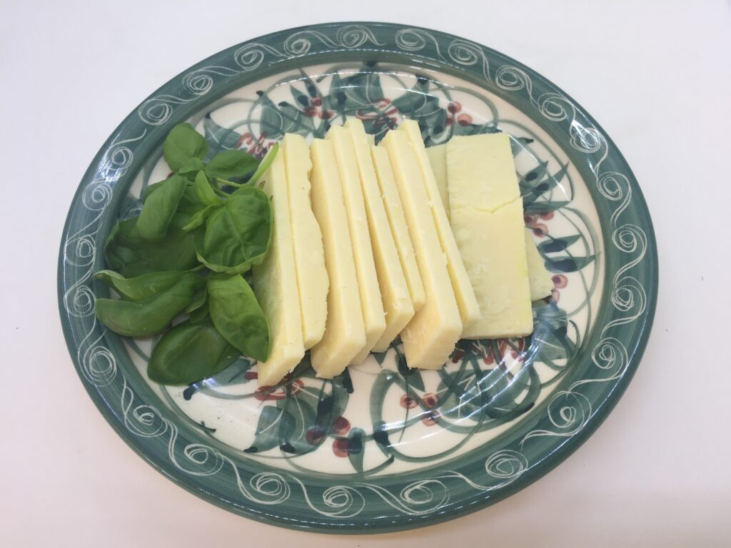 Sliced cheese and basil