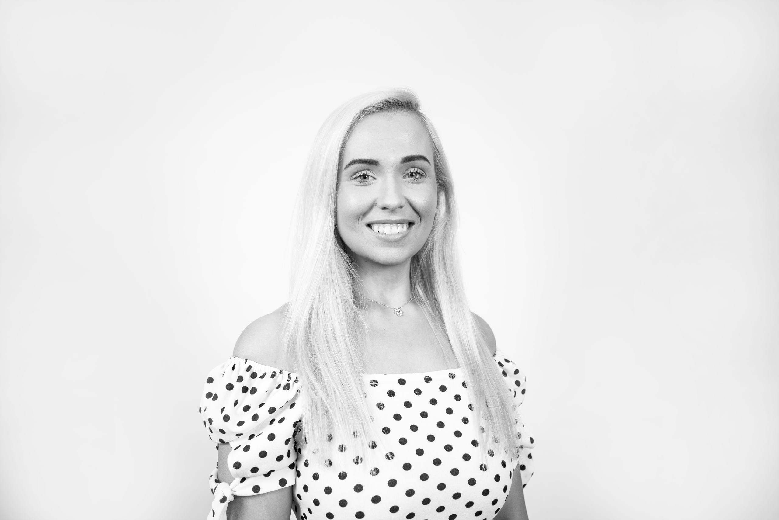 Blonde girl marketing executive smiles to camera for Prospect 13 marketing agency