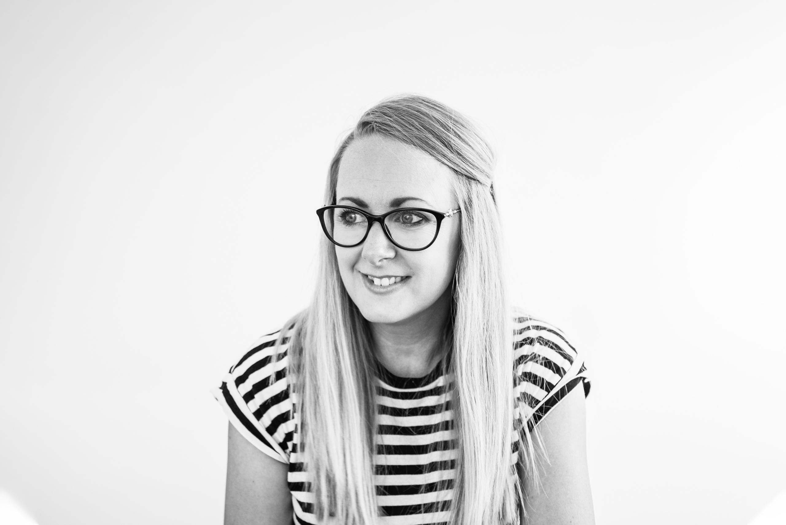 Blonde girl in glasses smiling graphic designer owner of whitespace studio