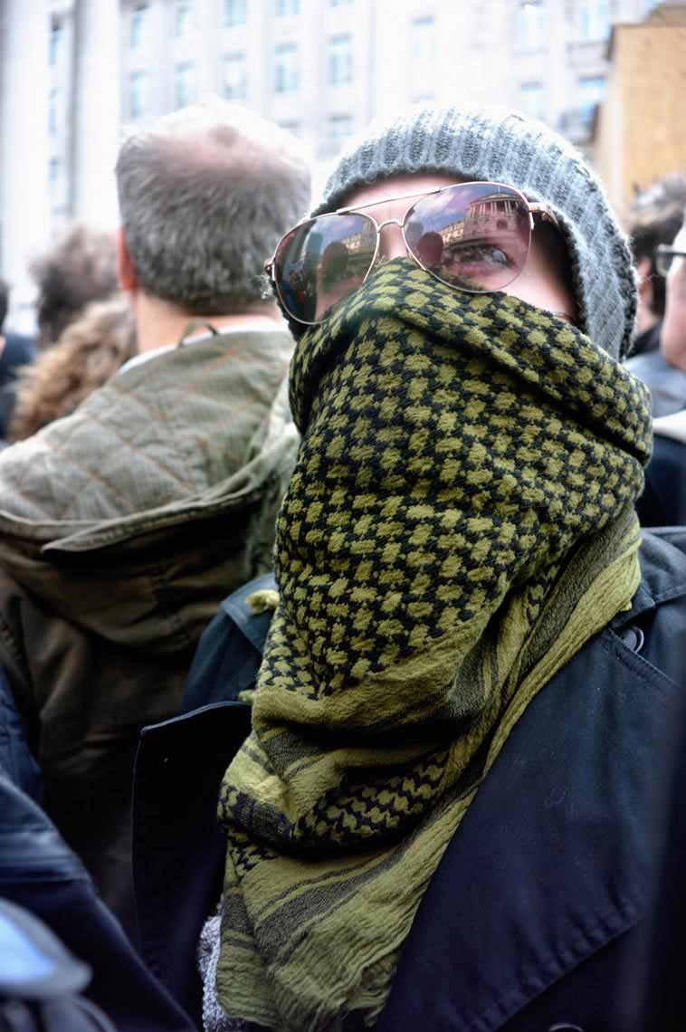 A protester with a covered face