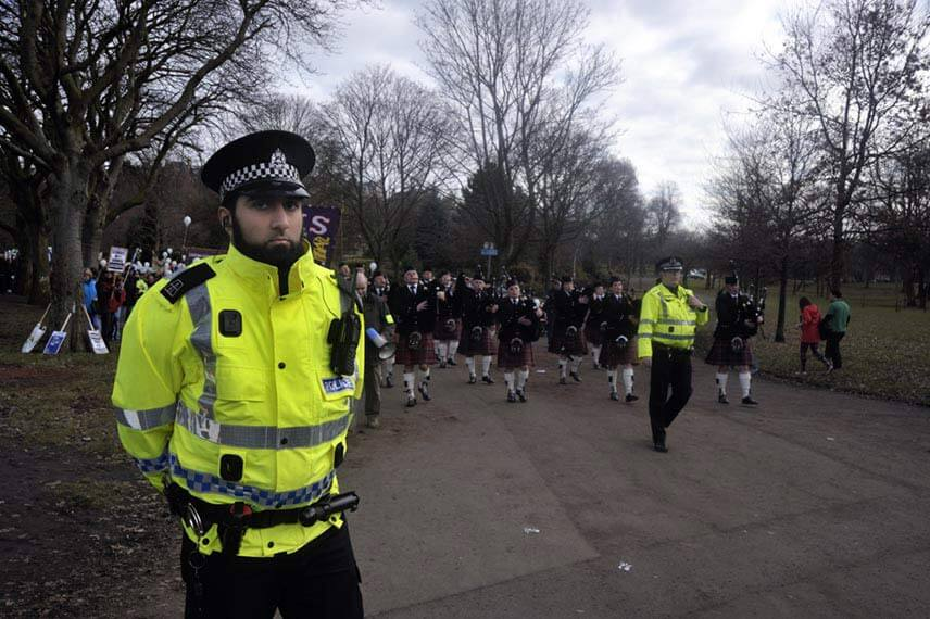 Police guarding a protest in Glasgow, Scotland