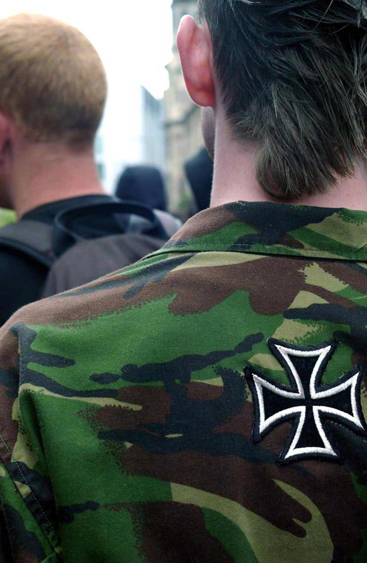 A protester with a cross emblem