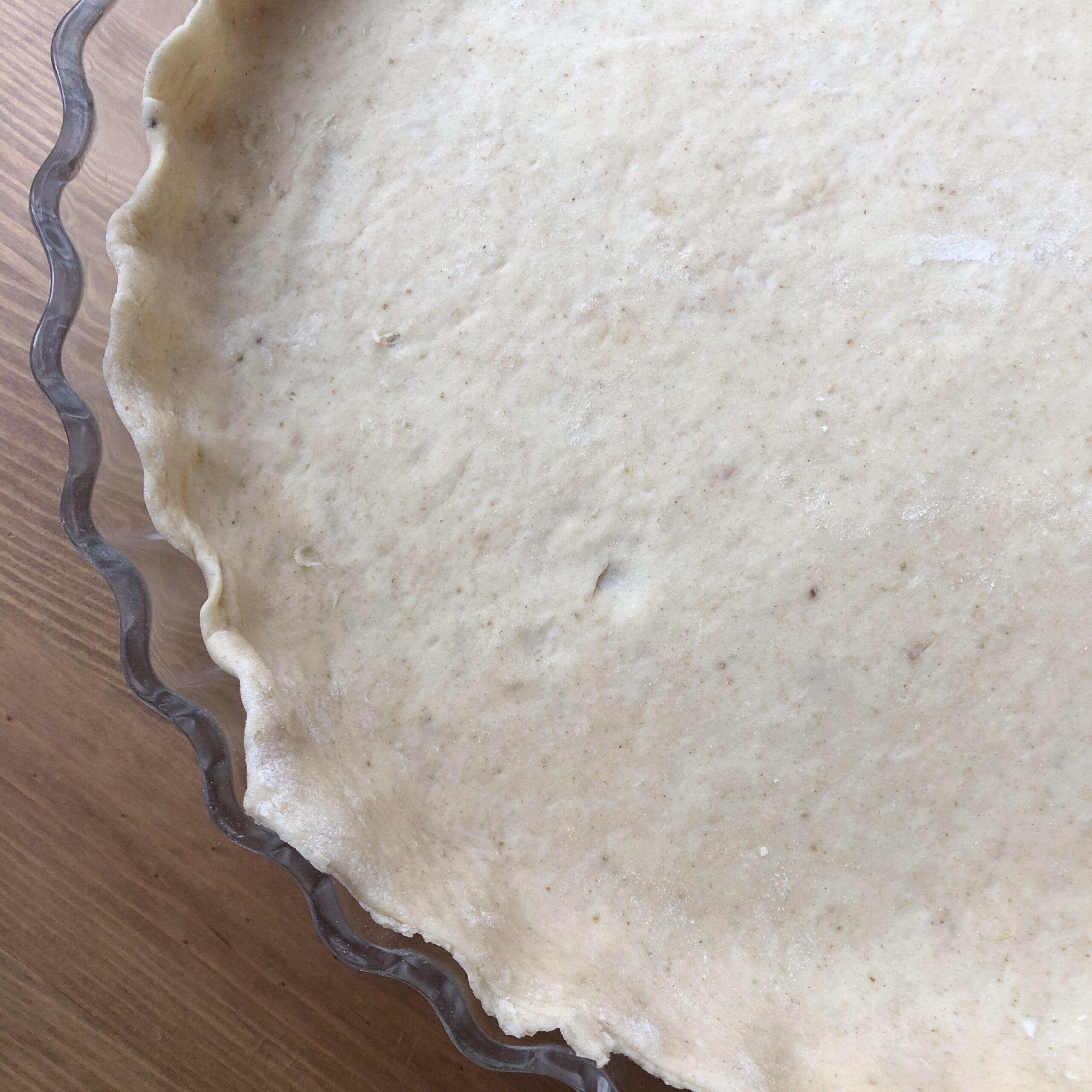 Zwiebelkuchen Teig ausgerollt