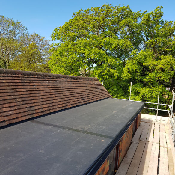 New EPDM flat dormer roof. Project completed by lead roofer and team of roofers