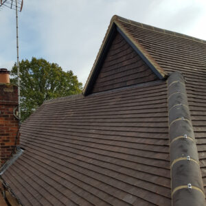 New mechanically fixed hip tiles and tile hung gable end. Project completed by lead roofer and team of roofers
