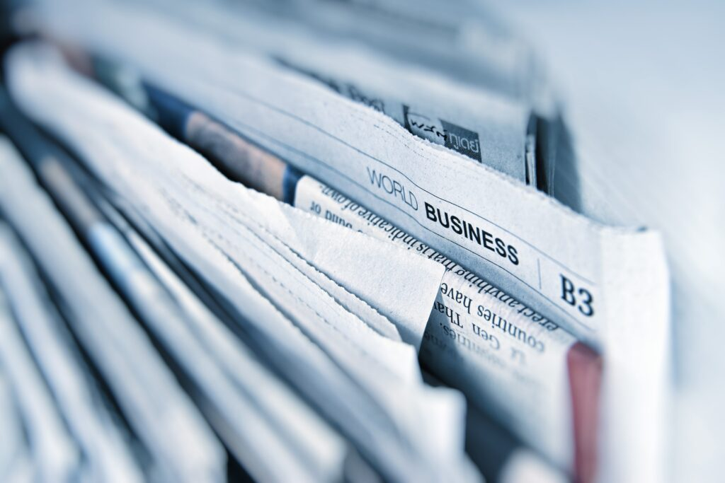 Picture of business section in a newspaper to showcase media coverage.
