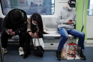 People on a train during the pandemic