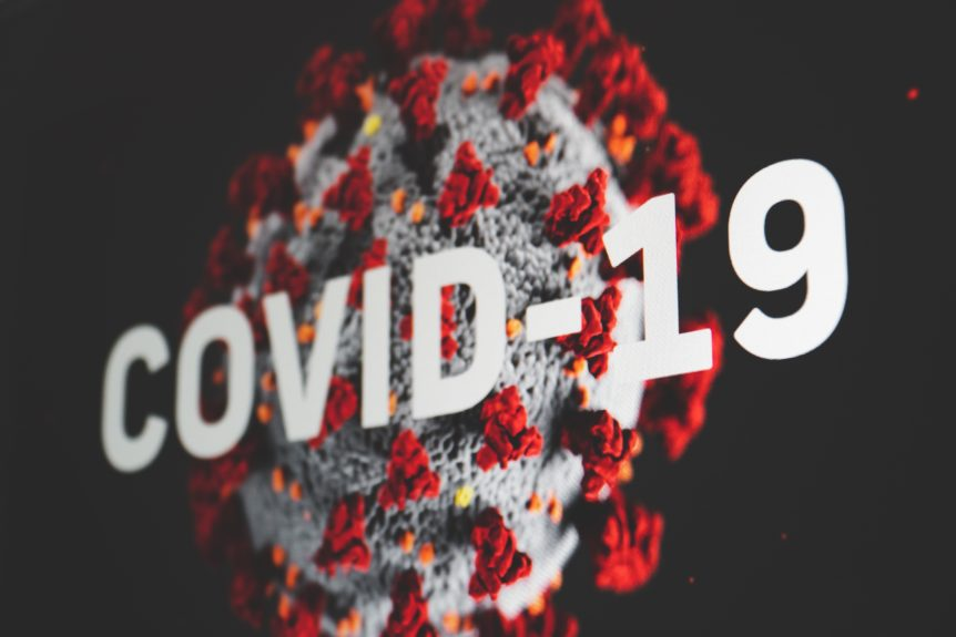 A virus cell with the words, 'Covid 19'