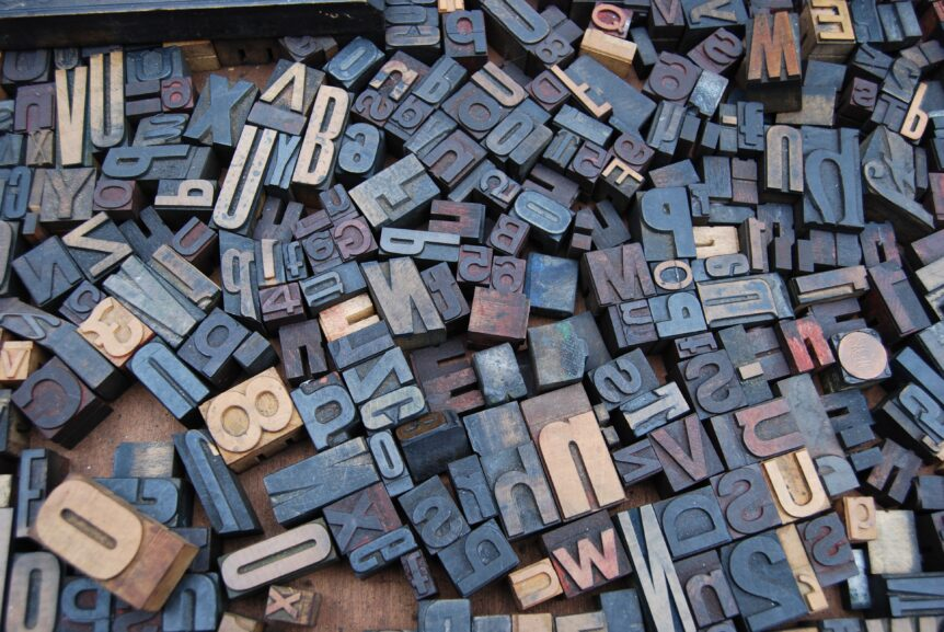 letters and numbers stamps jumbled together