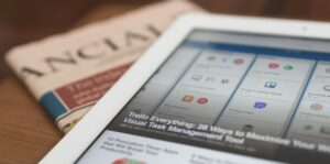 Ipad and newspaper depicting privacy setting