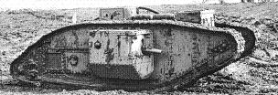 British Tank Mk V (male), spattered with mud, muddy field meeting the sky in the background