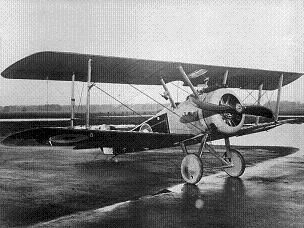 Grainy black and white photo of a Sopwith Camel fighter plane on the ground