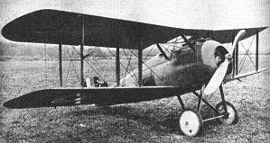 Black and white photograph of an unmanned Sopwith Snipe fighter plane resting on grass