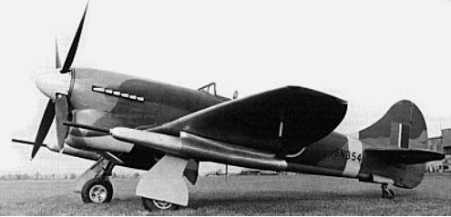 Black and white image of an experimental version of the Tempest V fighter plane, on the ground.