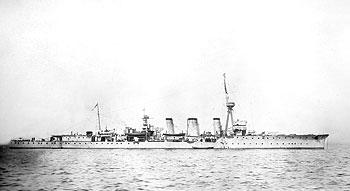 Black and white photo of HMS Caroline, a British Navy warship, on the sea