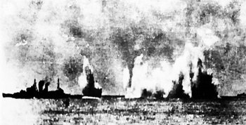 Fire and smoke on the sea, as British Navy cruiser HMS Exeter comes under attack