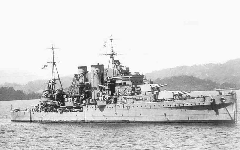 Black and white photograph of HMS Exeter, cruiser warship of the British Navy, moored off the coast of Sumatra