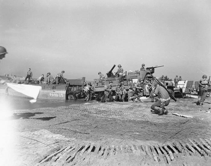 Troops and vehicles being landed under shell fire during the invasion of Italy at Salerno, September 1943