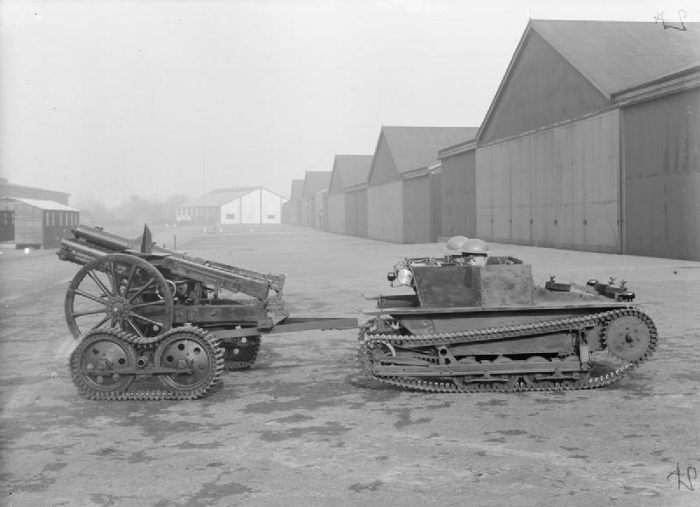 A Carden-Loyd tankette towing a 3.7 inch Howitzer