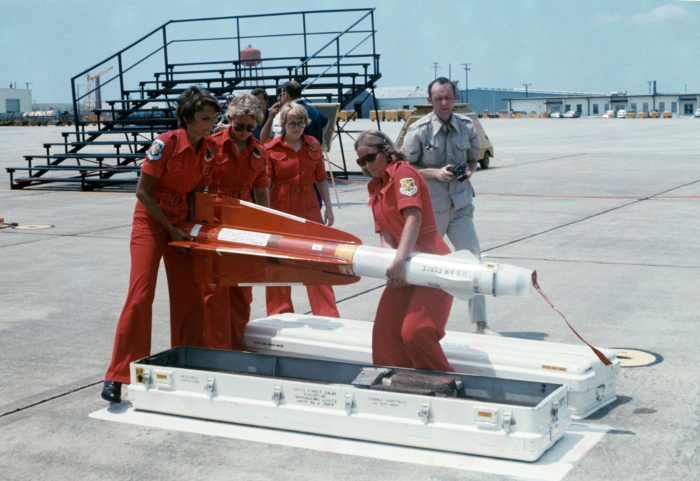 US Air Force personnel handling a AIM-4C missile