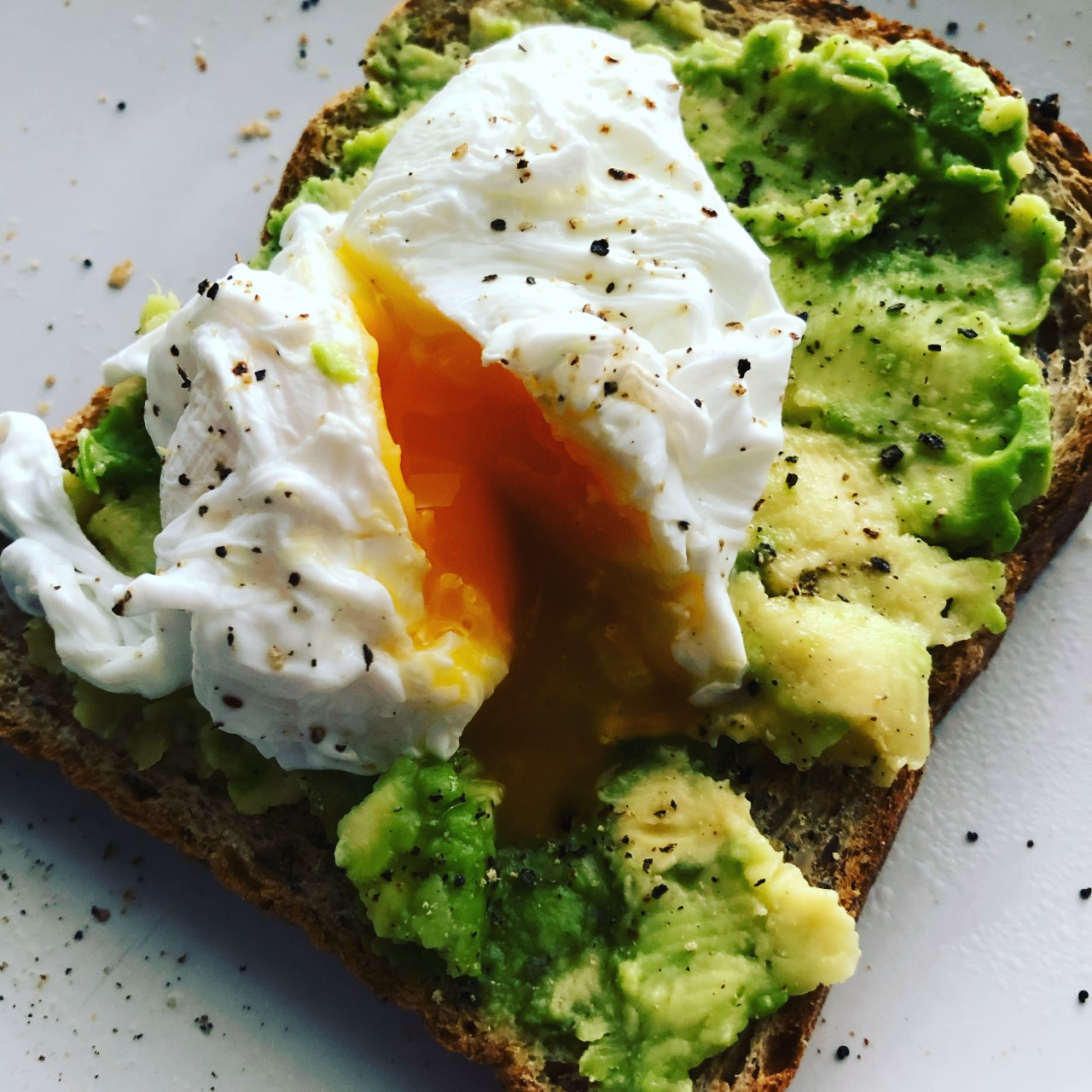 Crushed avocado and poached egg on toast