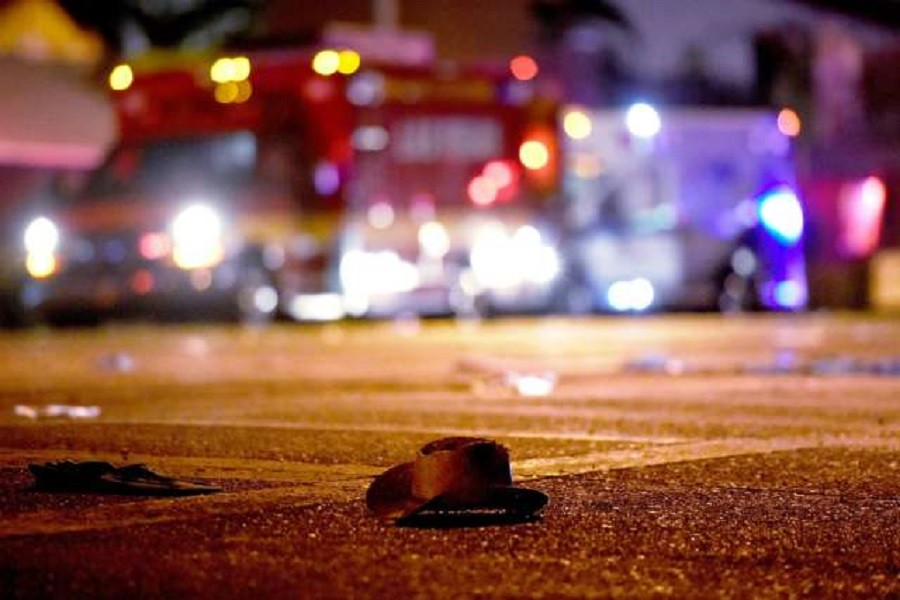 Single cowboy hat lies on the ground in the aftermath of the shooting